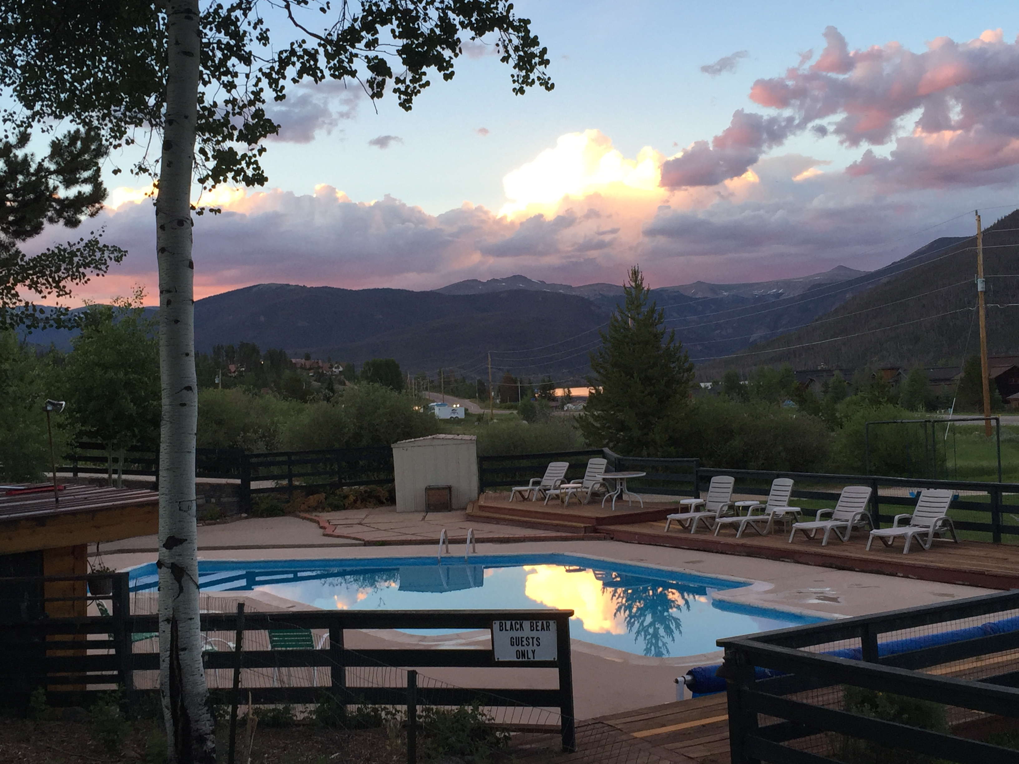 Outdoor heated pool at sunset